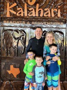 Baker family in front of the Kalahari Resorts sign