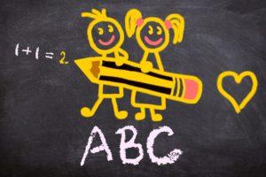 kids drawing on chalkboard for elementary education